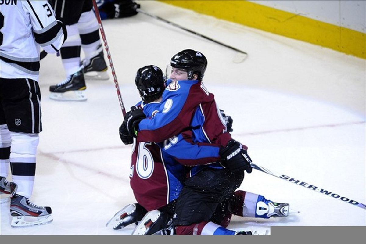 Feb 22 2012; Denver, CO, USA; Colorado Avalanche center Paul Stastny (26) is congratulated for his goal by center Matt Duchene (9) during the second period against the Los Angeles Kings at the Pepsi Center. Mandatory Credit: Ron Chenoy-US PRESSWIRE