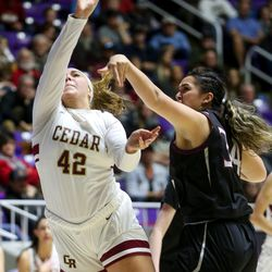 Pine View's Leiani Tonga (34) fouls Cedar's Denim Henkel (42) during the 4A girls championship basketball game at the Dee Events Center in Ogden on Saturday, Feb. 29, 2020.