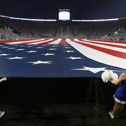 The American Flag is displayed during the national anthem in Provo on Saturday, Sept. 9, 2017. Utah won 19-13.