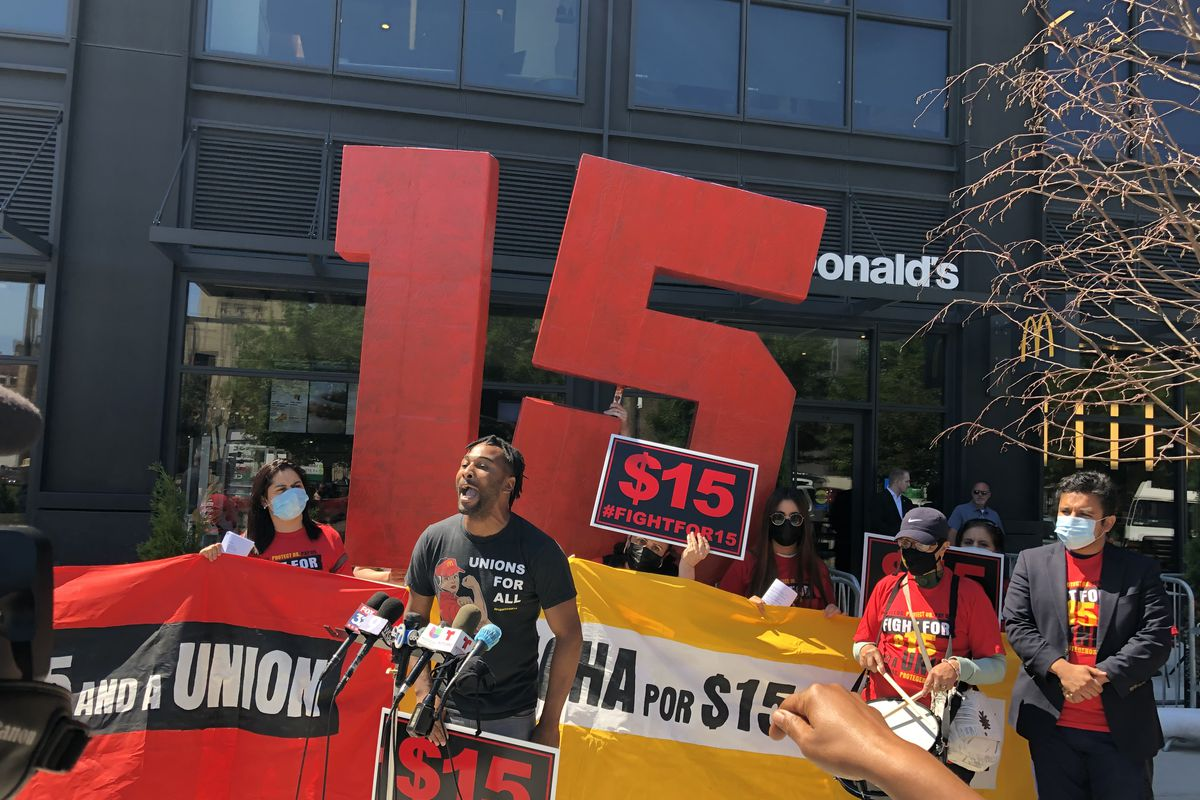 Troy Gaston speaks to McDonald's workers outside the company's West Loop headquarters Thursday at a rally celebrating the new $15 minimum wage in Chicago.