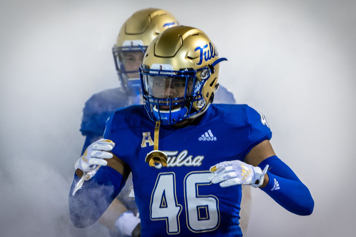 Tulsa Golden Hurricane linebacker Bershard Glaspie (46) enters the field through the fog prior to the game against the Southern Methodist Mustangs at H.A Chapman Stadium in Tulsa, Ok.