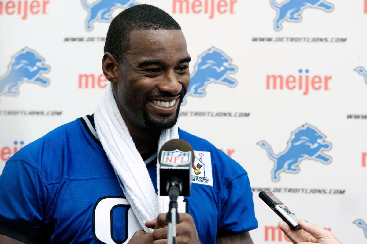July 27, 2012; Allen Park, MI, USA; Detroit Lions wide receiver Calvin Johnson (81) speaks with the media after training camp at the Detroit Lions training facility. Mandatory Credit: Tim Fuller-US PRESSWIRE