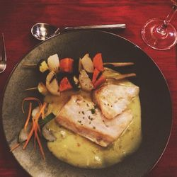 The dish was a Pacific salmon that was white—I'd never had anything like it before. It was served with a curry broth and simple, skewered vegetables. All of the flavors merged together perfectly.