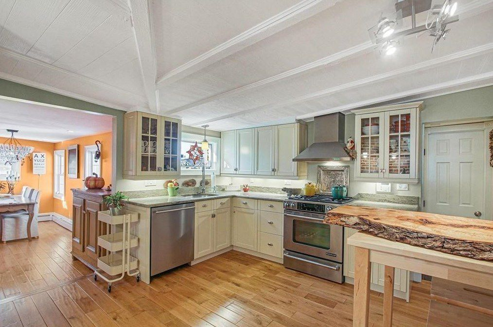An open, airy kitchen with a cutting-board-like island in the middle.