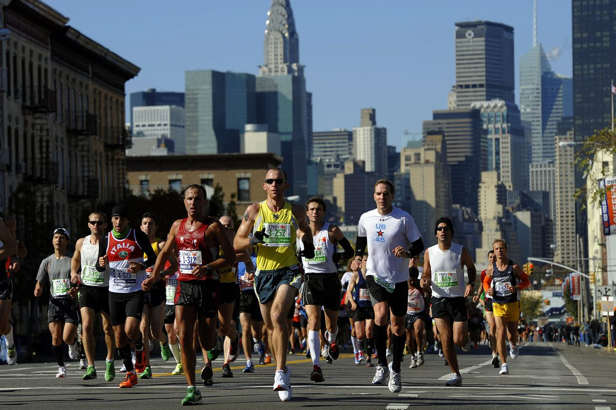 Marathoners run through Queens during the 2011 New York City Marathon