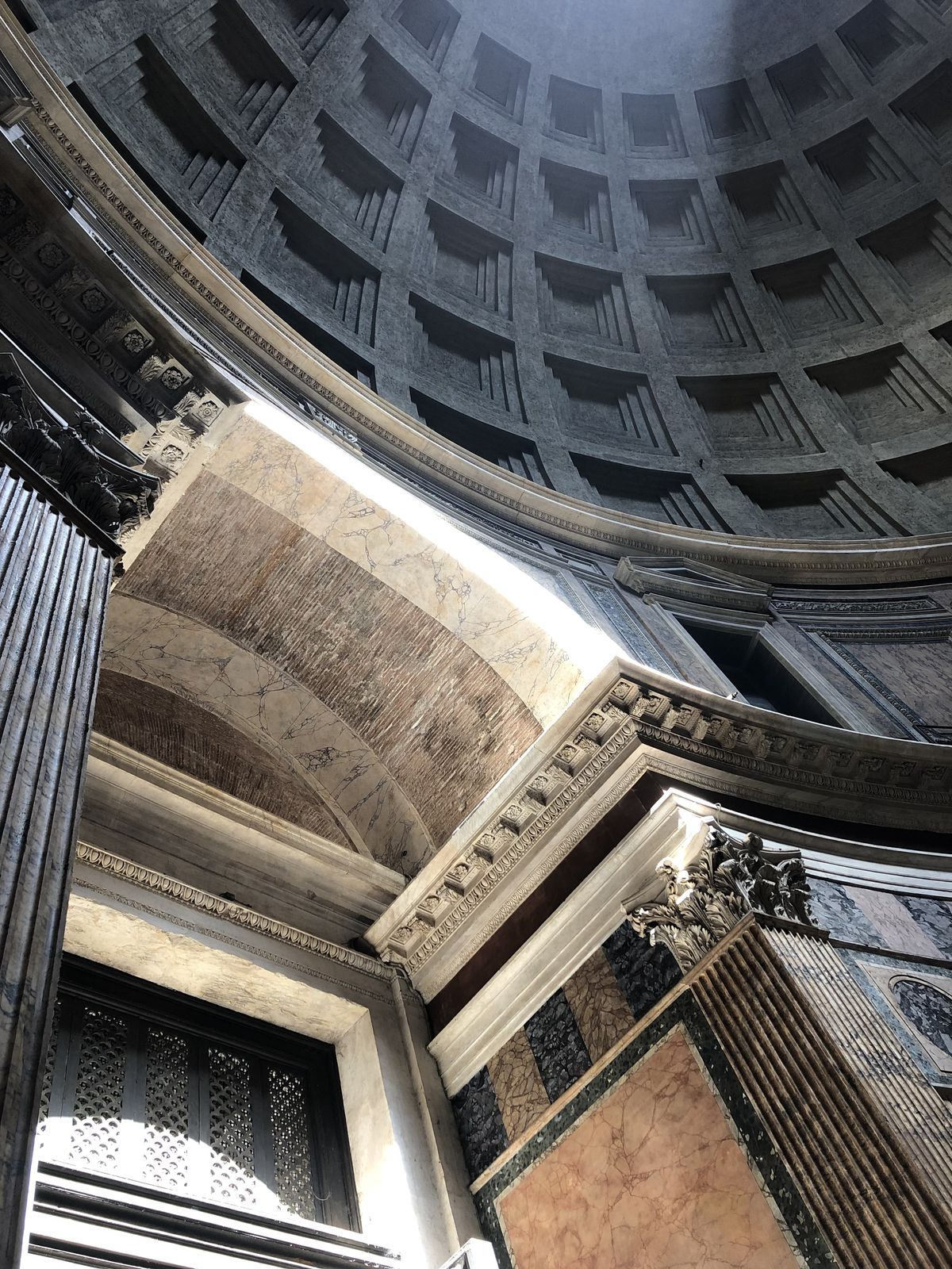 A dark, domed ceiling made of concrete.