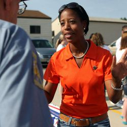 Mia Love discusses politics before walking in the Harvest Days Parade in Midvale on Saturday, Aug. 11, 2012.