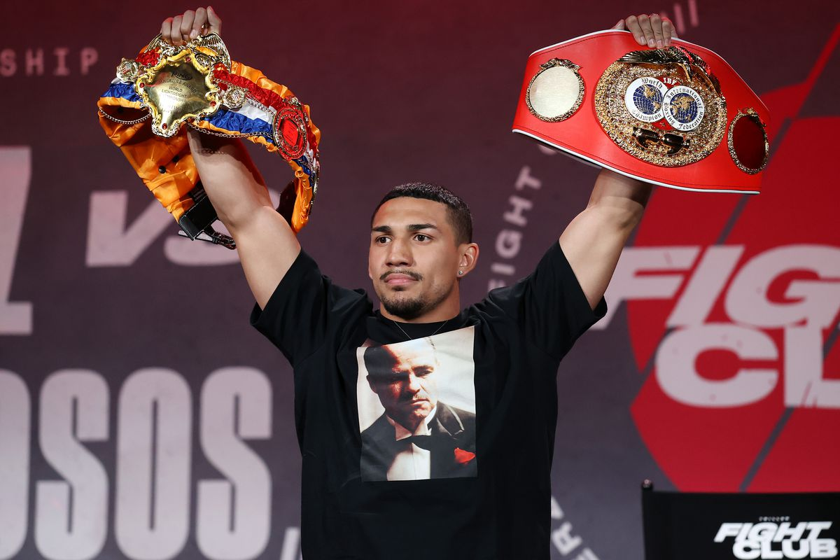 Teofimo Lopez poses with his championship belts during a press conference for Triller Fight Club at Mercedes-Benz Stadium on April 16, 2021 in Atlanta, Georgia ahead of his June 5 lightweight title fight against George Kambosos Jr.