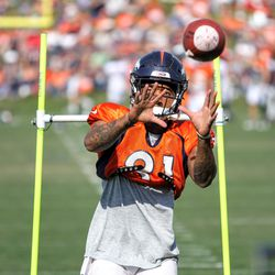 Broncos WR Tim Patrick looks through his fingers to receive the pass.