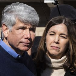 Former Illinois Gov. Rod Blagojevich's wife, Patti Blagojevich, looks on as he gets emotional while speaking to reporters outside the family's Ravenswood Manor home the day after he was released from a Colorado prison, Wednesday afternoon, Feb. 19, 2020. President Donald Trump on Tuesday commuted Blagojevich's 14-year prison sentence on charges of public corruption.