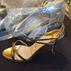 Plain heel with hardware, size 37, $150