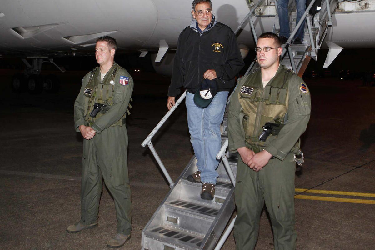 U.S. Defense Secretary Leon Panetta, center,  steps off his jet after arriving at Yokota Air Base on the outskirts of Tokyo, Japan, Sunday, Sept. 16, 2012.  Panetta is in Japan as part of his Asian tour which includes China and New Zealand.