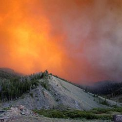 This Tuesday, June 26, 2012 photo provided by the U.S. Forest Service shows the Fontenelle Fire burning in the Bridger-Teton National Forest, Wyo.