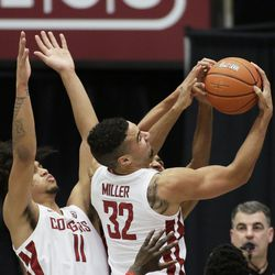 Washington State forward Tony Miller (32) grabs a rebound next to forward DJ Rodman (11) during the second half of the team's NCAA college basketball game against Utah in Pullman, Wash., Thursday, Jan. 21, 2021.