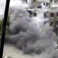 In this image made from amateur video released by the Shaam News Network and accessed Sunday, April 15, 2012, smoke rises from buildings following purported shelling in Homs, Syria.  Syrian troops are reported to have shelled residential neighborhoods dominated by rebels in the central city of Homs Sunday, activists said, killing at least three people hours before the first batch of United Nations observers were to arrive in Damascus to shore up a shaky truce.