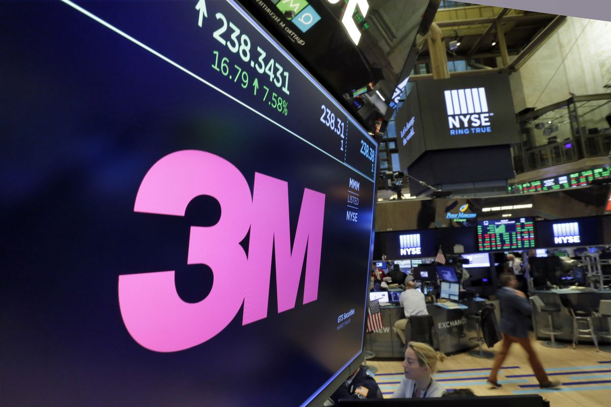 FILE- In this Oct. 24, 2017, file photo, the logo for 3M appears on a screen above the trading floor of the New York Stock Exchange. A profound slump in manufacturing and a trade war that has slowed economic growth in China has led to a second round of layoffs at 3M, the Minnesota company that, in addition to Post-it notes, makes industrial coatings and ceramics. (AP Photo/Richard Drew, File)