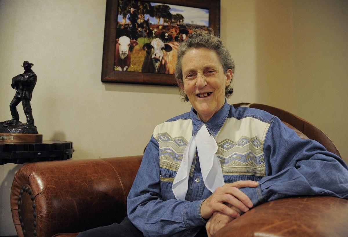 Temple Grandin sitting in leather chair wearing denim shirt