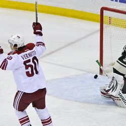 Phoenix Coyotes' Antoine Vermette, left, celebrates a goal by Mikkel Boedker off Minnesota Wild goalie Niklas Backstrom (32), of Finland, in the first  period of an NHL hockey game on Saturday, April 7, 2012, in St. Paul, Minn.