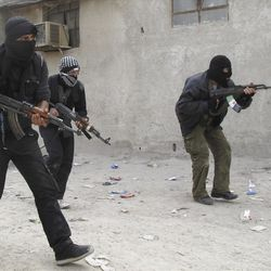 In this Sunday, April 1, 2012 photo, Free Syrian Army fighters train in a neighborhood of Damascus, Syria. Government and opposition forces clashed across Syria Monday as international envoy Kofi Annan prepared to brief the U.N. Security Council on the progress of his mission to ease the Syrian crisis.