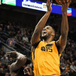 Utah Jazz forward Derrick Favors (15) shoots over Houston Rockets guard James Harden (13) as the Utah Jazz host the Houston Rockets at Vivint Smart Home Arena in Salt Lake City on Thursday, Dec. 7, 2017.