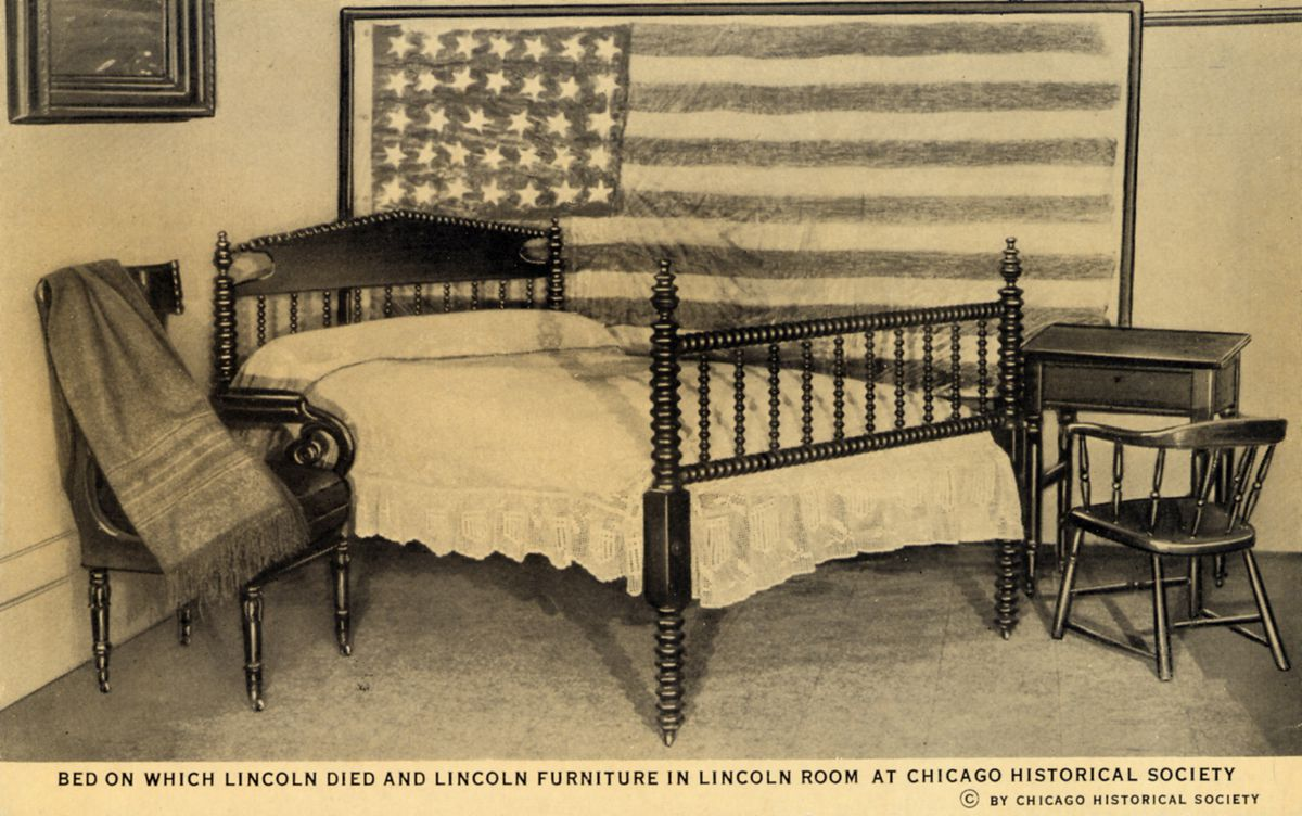 A postcard showing the bed where Lincoln died, perfectly preserved. (Curt Teich Postcard Archives/Contributor/Getty Images)
