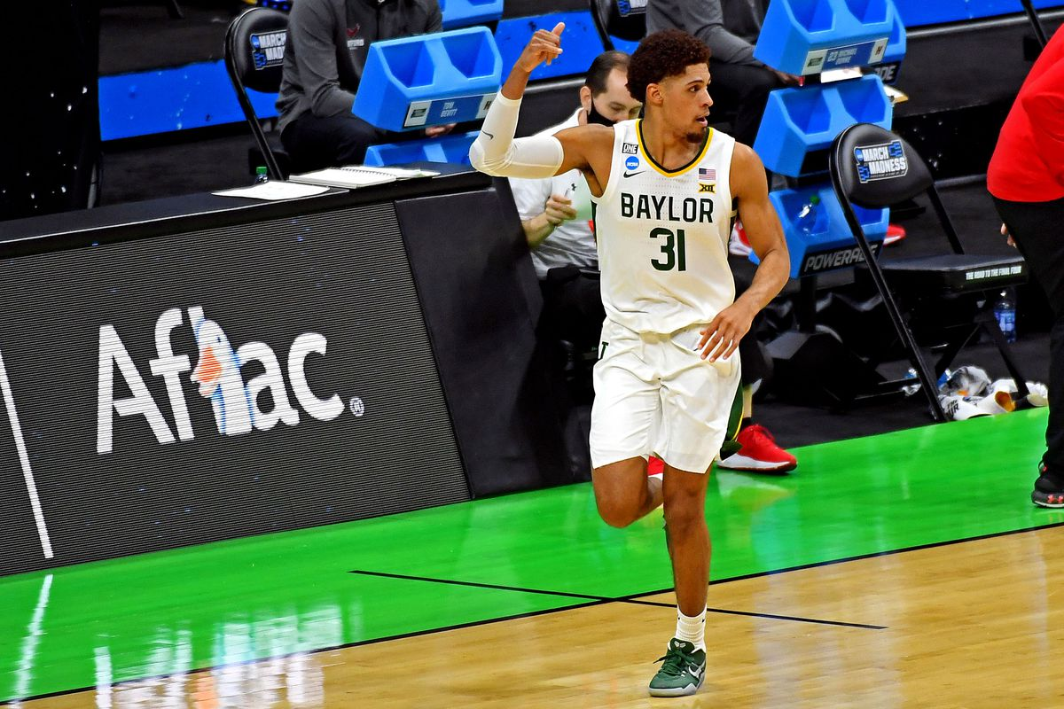 Baylor Bears guard MaCio Teague (31) reacts after a play during the first half against the Hartford Hawks during the first round of the 2021 NCAA Tournament at Lucas Oil Stadium.