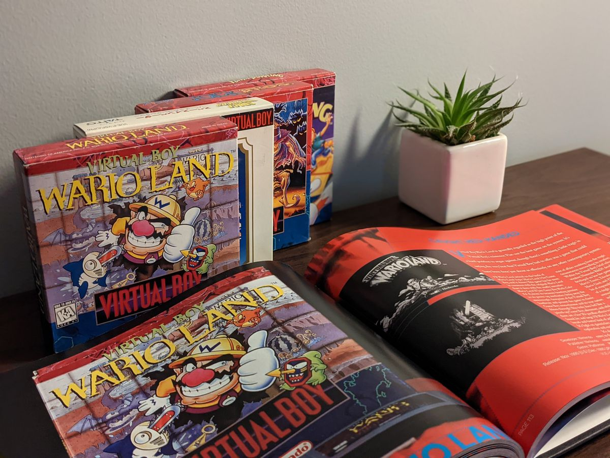A book about Virtual Boy games is opened to the Wario Land page.