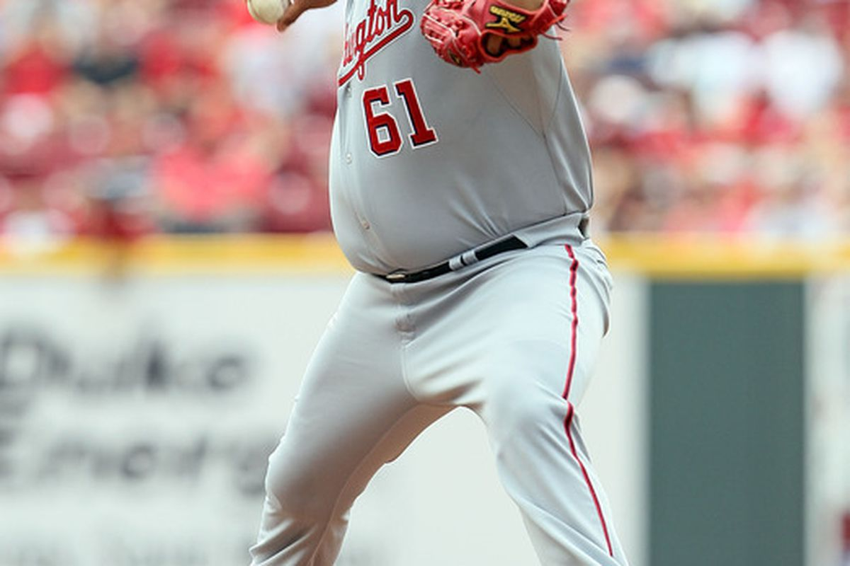 CINCINNATI - JULY 22:  Livan Hernandez #61 of the Washington Nationals throws a pitch during the game against the Cincinnati Reds at Great American Ball Park on July 22 2010 in Cincinnati Ohio.  (Photo by Andy Lyons/Getty Images)