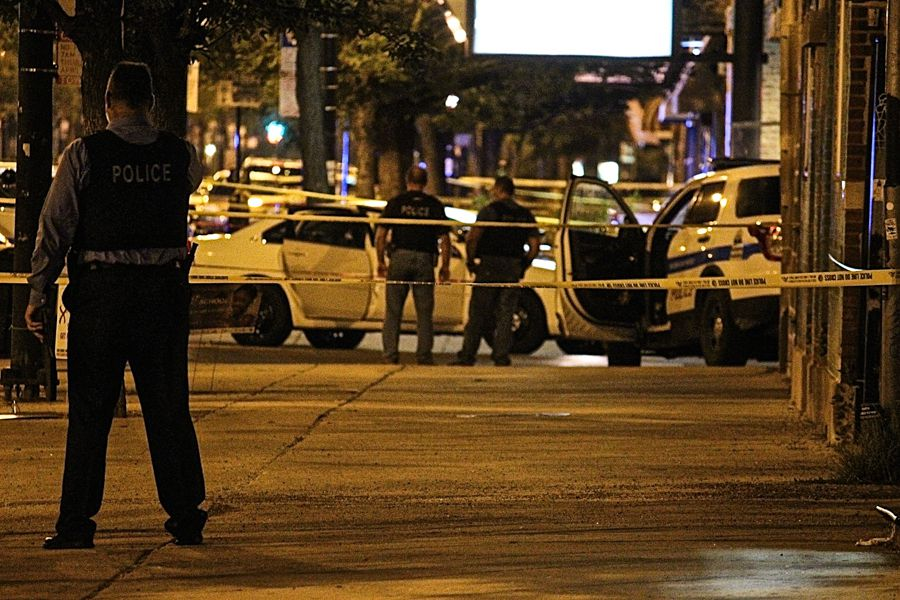 An unmarked squad car is parked in the crime scene in Humboldt Park early Saturday. | Daniel Brown/Sun-Times