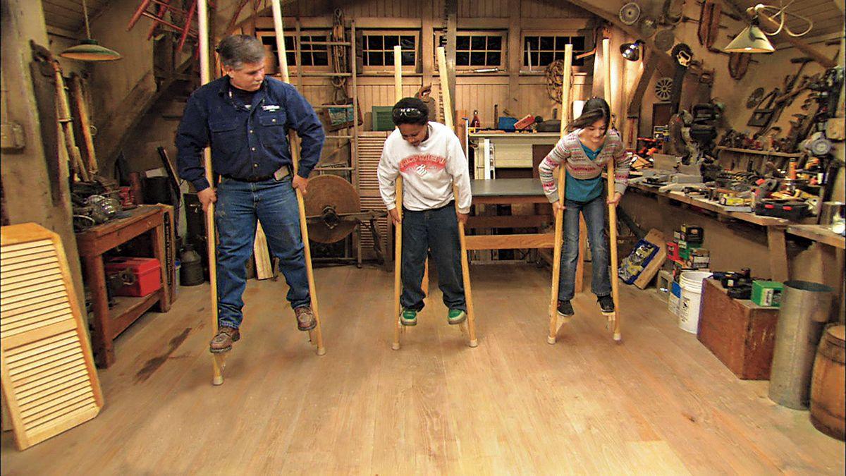 Tom Silva and kids using the stilts.