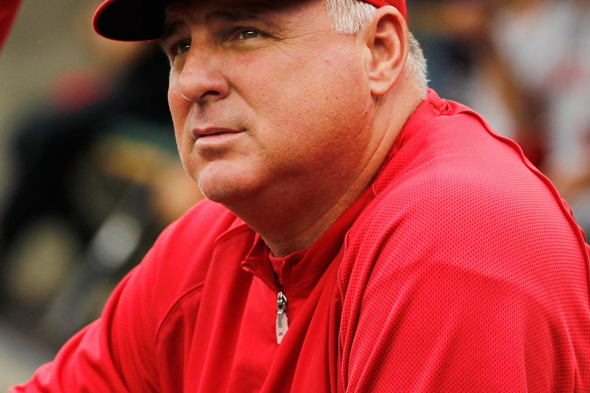DETROIT, MI - JULY 19: Manager Mike Scioscia looks on from the dugout while playing the Detroit Tigers at Comerica Park on July 19, 2012 in Detroit, Michigan.  (Photo by Gregory Shamus/Getty Images)