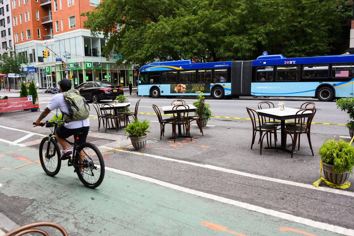 Tables are set for outdoor dining outside a restaurant on the Upper East Side as New York City moves into Phase 2 of re-opening following restrictions imposed to curb the coronavirus pandemic on June 30, 2020.