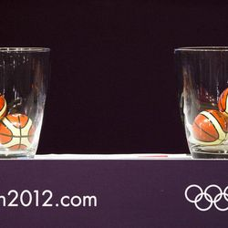 Capsules that resemble little basket balls containing the names of countries sit on stage prior to the start of the London 2012 Olympic basketball tournament draw ceremony in Rio de Janeiro, Brazil, Monday, April 30, 2012. Basketball at the London 2012 Olympic Games will be held from July 28 to Aug. 12.