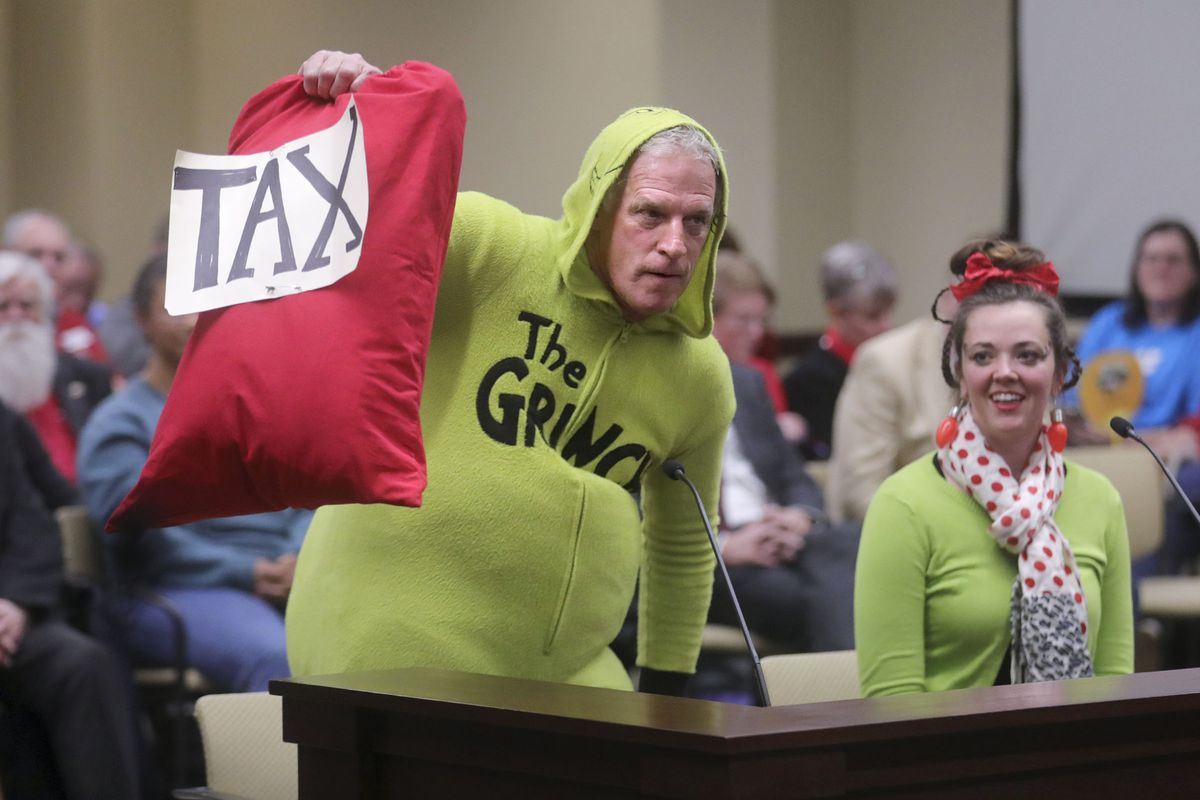 Greg Zenger, dressed at the Grinch, gives a public comment during a Tax Restructuring and Equalization Task Force meeting in the House Building at the state Capitol in Salt Lake City on Monday, Nov. 25, 2019.