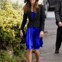 Wearing a blue Issa dress for the October 2008 wedding of Harry Meade And Rosie Bradford.