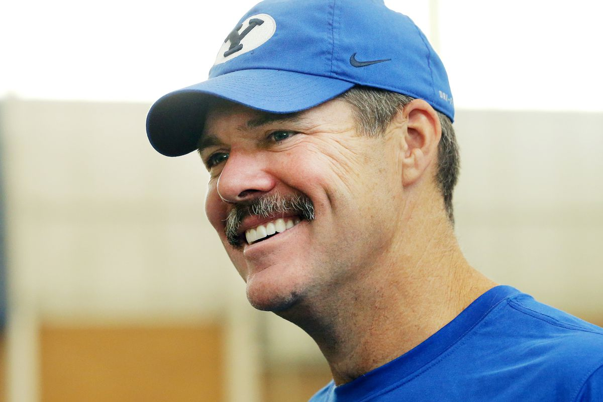 BYU's offensive coordinator Jeff Grimes talks with friends and media after a walkthrough in their indoor practice facility in Provo on Friday, Aug. 10, 2018.