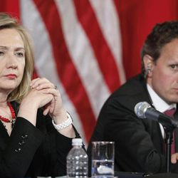 In this photo taken May 10, 2011, U.S. Secretary of State Hillary Rodham Clinton, left, and Treasury Secretary Timothy Geithner listen near the end of a joint meeting of the U.S.-China Strategic and Economic Dialogue (S&ED), at the Department of the Interior in Washington. Attention returns to China this coming week when Clinton and Geithner attend strategic and economic talks in Beijing.