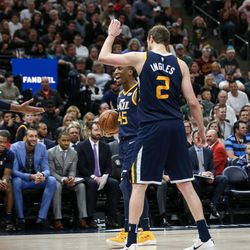 Utah Jazz guard Donovan Mitchell (45) and forward Joe Ingles (2) high-five forward Thabo Sefolosha (22) after he and Cleveland Cavaliers forward LeBron James (23) were both charged with technical fouls at Vivint Arena in Salt Lake City on Saturday, Dec. 30, 2017.