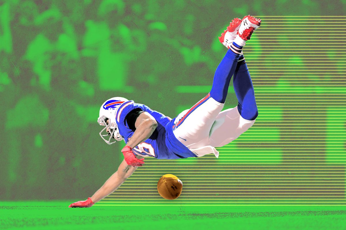 Buffalo Bills player Andrew Holmes diving for the football