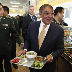U.S. Defense Secretary Leon Panetta carries his lunch with cadets in the mess hall at the PLA Engineering Academy of Armored Forces in Beijing, Wednesday, Sept. 19, 2012.  U.S. Defense Secretary Panetta is telling Chinese troops that America's new military focus on the Asia Pacific, including plans to put a second radar system in Japan, is not an attempt to contain or threaten China.