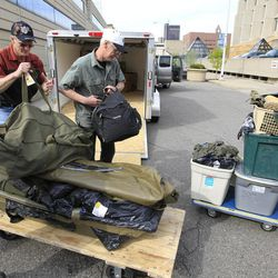 David Stone, right, and his brother Ron Stone, load a trailer after the FBI returned David Stone's possessions, that were seized in March 2010, outside the federal building in Detroit, Friday, April 20, 2012. Much of the returned gear is military-style vests and other accessories worn by members of the Hutaree militia when they trained in the woods of southern Michigan. A judge last month cleared the Stones and five other people of conspiring to wage war against the government.