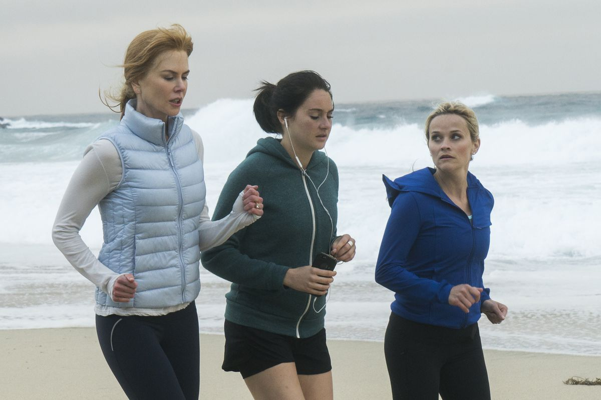Celeste, Jane, and Madeline running along the beach in Big Little Lies.