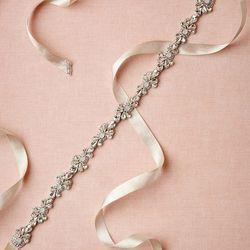 "<a href=""http://www.bhldn.com/shop-the-bride-bridal-accessories/sparkled-skinny-sash/productoptionids/2cfdddea-ce77-41fb-bdf9-1bdcb7ca63f8"">Sparkled Skinny Sash</a>, $200"