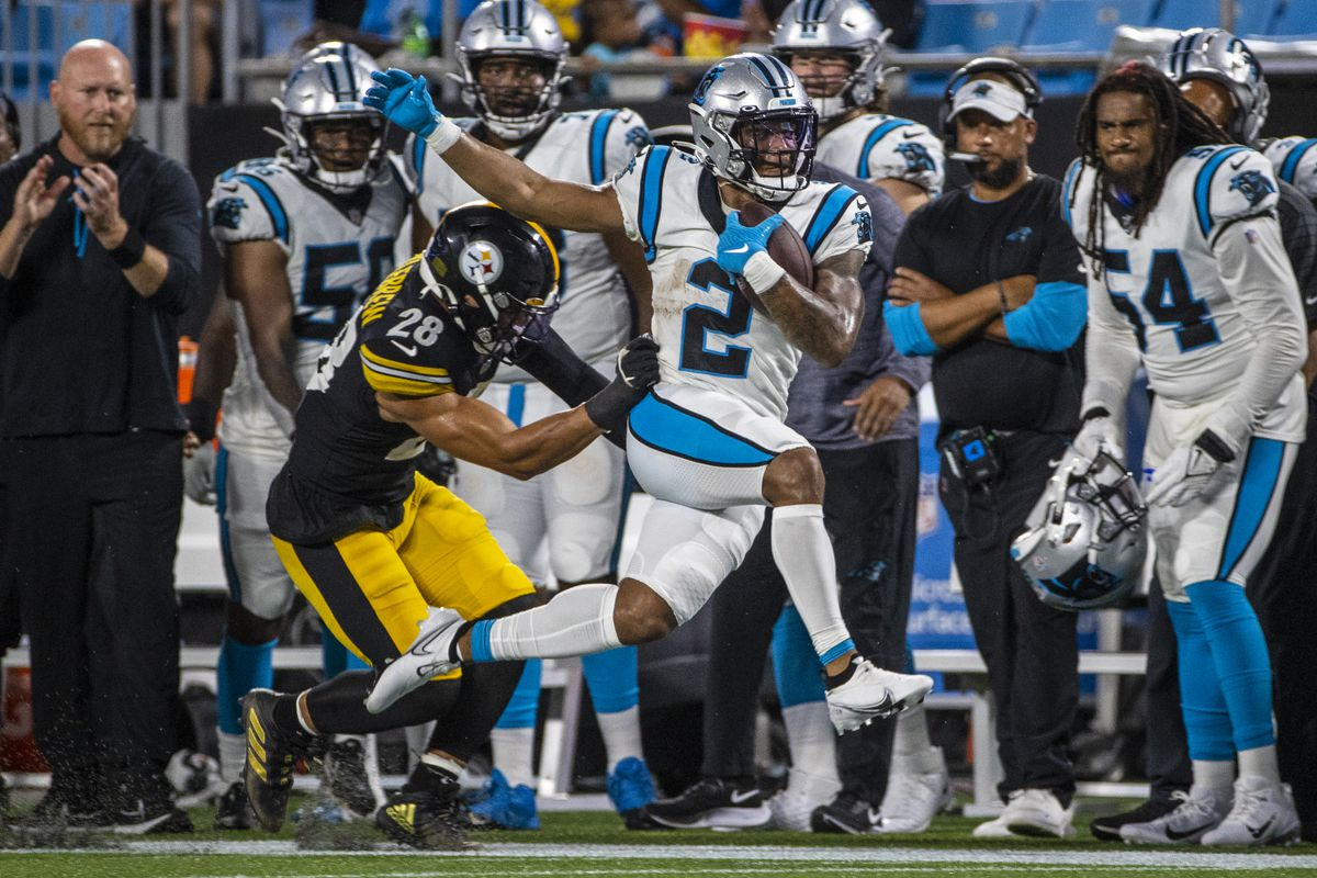 D.J. Moore #2 of the Carolina Panthers is pushed by Miles Killebrew #28 of the Pittsburgh Steelers during the first half of an NFL preseason game at Bank of America Stadium on August 27, 2021 in Charlotte, North Carolina.