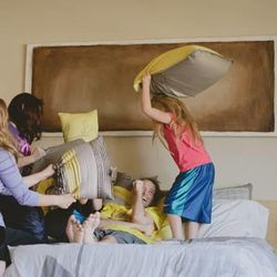 Madison, McKenna and Rosie Goade play with their father, Rich.