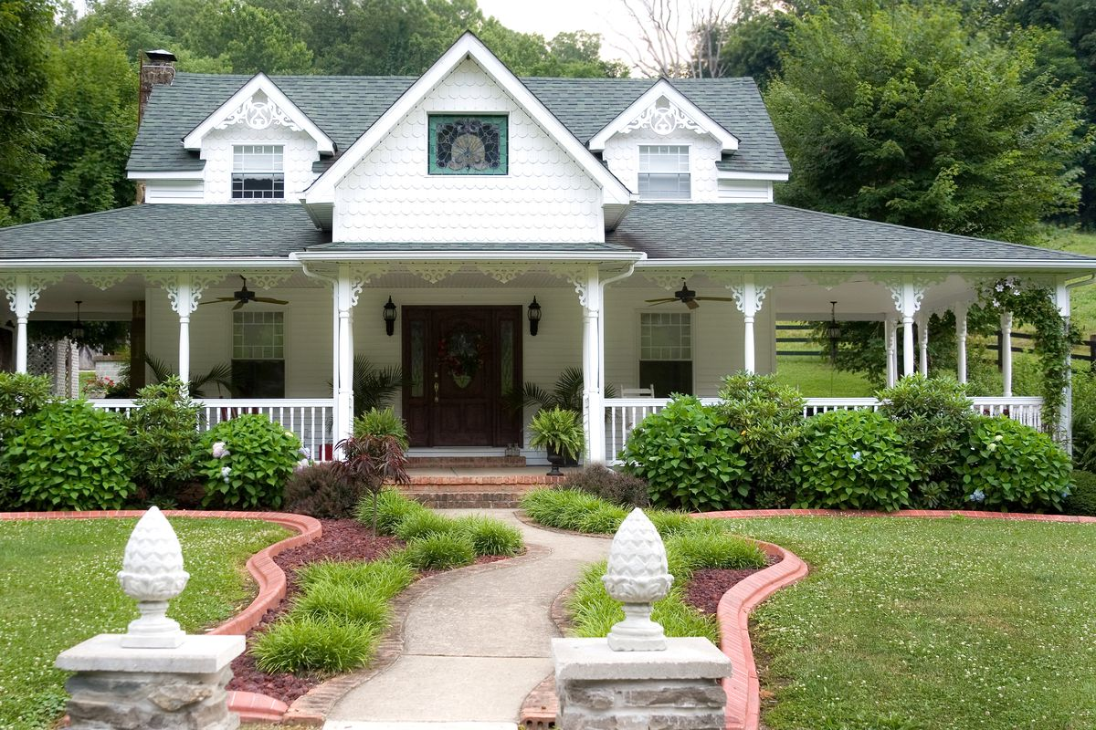 Victorian-style home with wraparound porch.