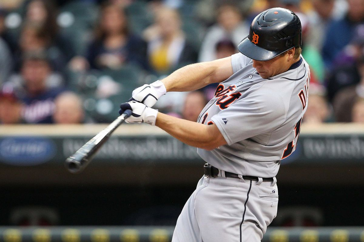 May 26, 2012; Minneapolis, MN, USA: Detroit Tigers left fielder Andy Dirks (12) hits a double in the first inning against the Minnesota Twins at Target Field. Mandatory Credit: Jesse Johnson-US PRESSWIRE