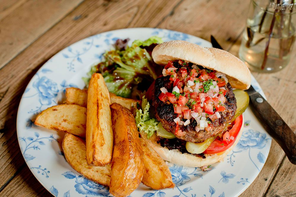 A burger and potato wedges at Forest Tavern, one of the best restaurants in Forest Gate