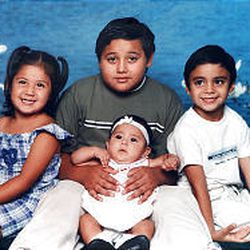 """Yanira Robles, 4, and Jorge """"Teto"""" Robles-Almeda, 9, in back, were killed. Christopher Robles, 6, right, is in critical condition. The Robleses also have a 4-month-old, Diana, front."""