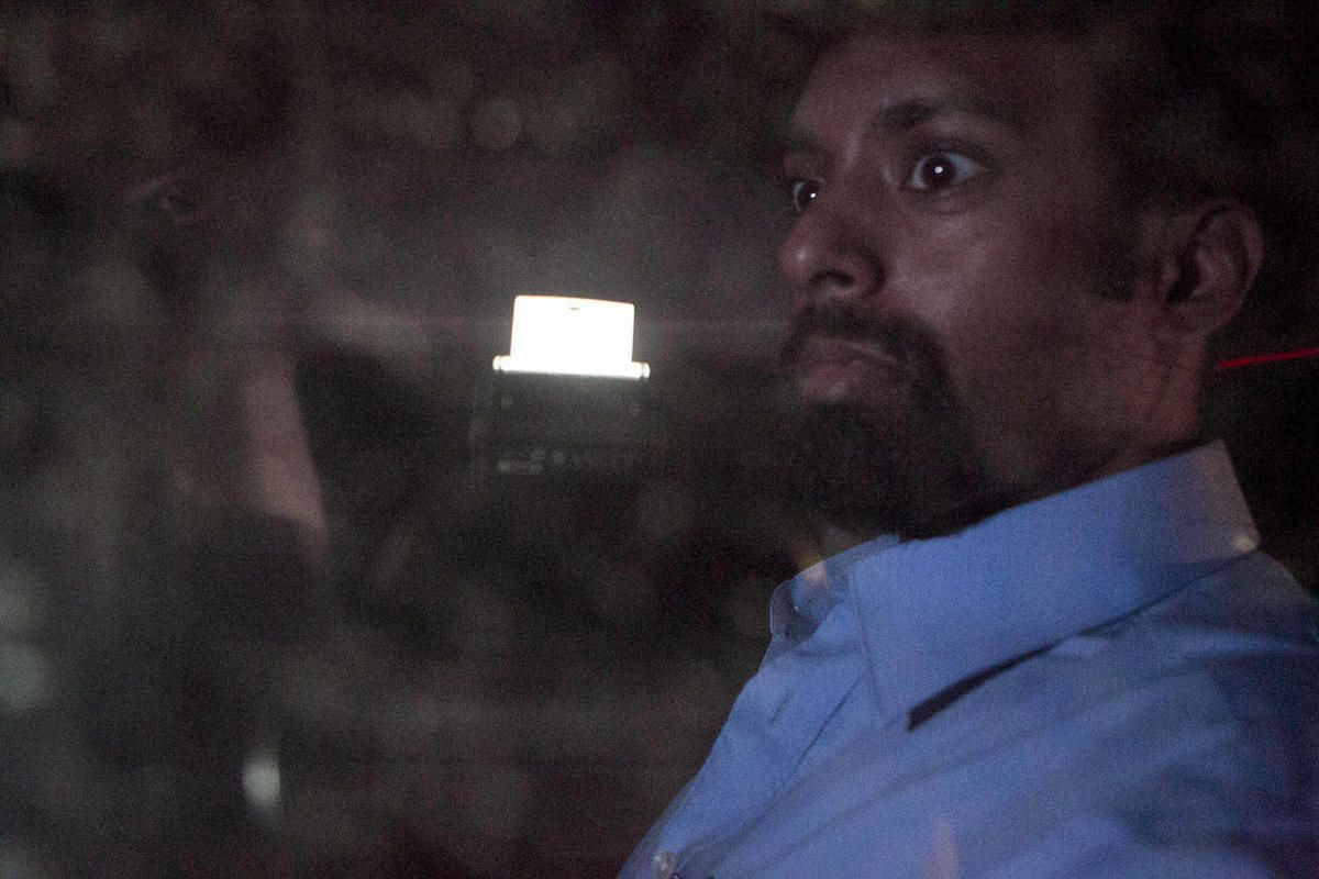 U.S. citizen Jason Puracal sits behind a car window as he leaves jail after being released in Tipitapa, Nicaragua, late Thursday, Sept. 13, 2012.  Puracal, who was jailed for nearly two years in Nicaragua on money-laundering and drug charges, was released